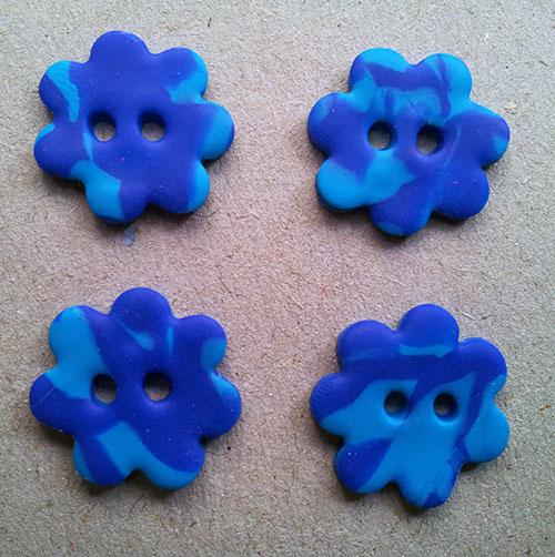 Set of four blue handmade Fimo flower buttons